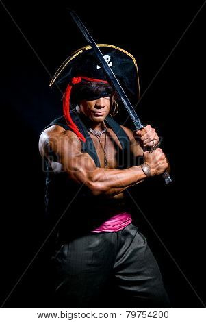 Muscular Man In A Pirate Hat And Sword On A Black Background