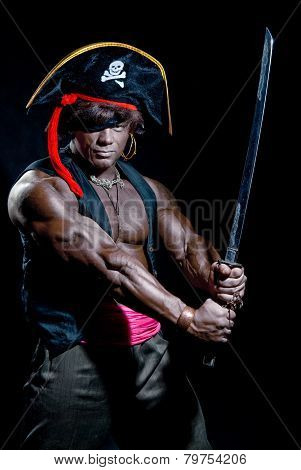 Muscular Black Man In A Pirate Hat And Sword On A Black Background