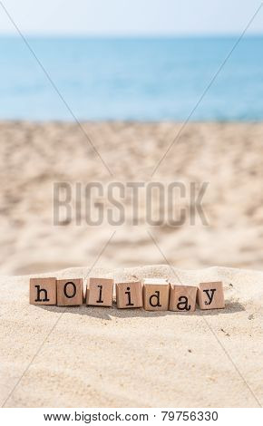 Holiday Season Word And Sunny Beach Background