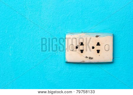 Old Power Outlet On Green Background