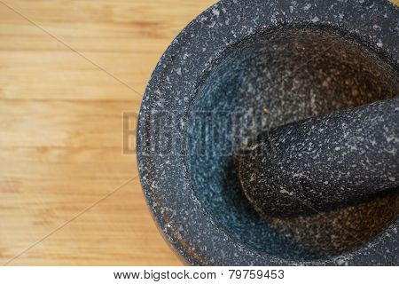 Mortar and pestle on wooden chopping board