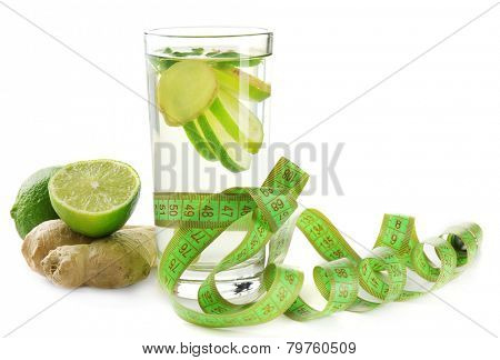 Dietary cocktail with slices of lemon and centimeter on table and white background