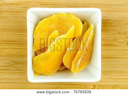 Dehydrated Dried Mango In White Bowl On Wooden Background