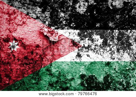 Jordanian flag painted on grunge wall