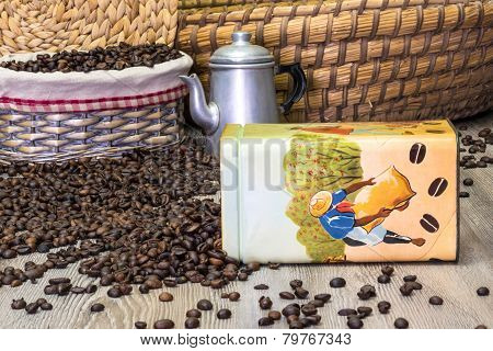 Coffee, fresh aromatic coffee beans in a metal box with coffee pot