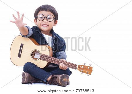 Cute boy playing the ukulele