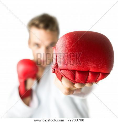 Kickboxer With Red Boxing Gloves Performing A Martial Arts Punch