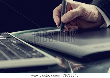 Graphic Designer Working With Digital Tablet Pen