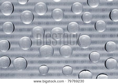 Binary Code Through Water Drops On Glass