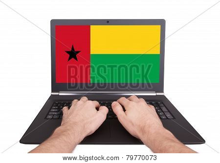 Hands Working On Laptop, Guinea-bissau