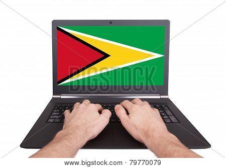 Hands Working On Laptop, Guyana