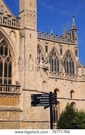 Gloucester Cathedral and signpost.
