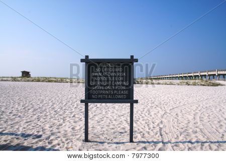 The White Sands of Navarre Beach With Sign and Lifeguard Shack