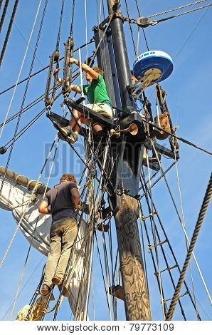 Men attending to rigging.