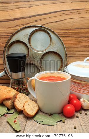 Tomato Soup In A Cup With Bread And Vegetable Around