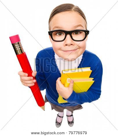Funny little girl is holding books and a big pencil, fisheye portrait, isolated over white