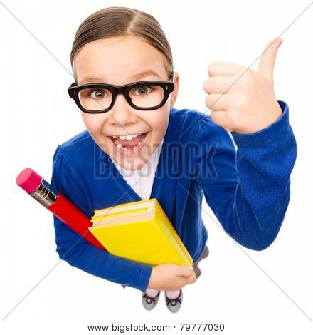 Funny little girl is holding books and showing thumb up sign, fisheye portrait, isolated over white
