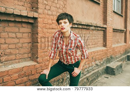Portrait of a beauty brunette with short hair