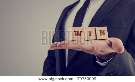 Retro Image Of Businessman Holding Wooden Alphabet Blocks Reading Win