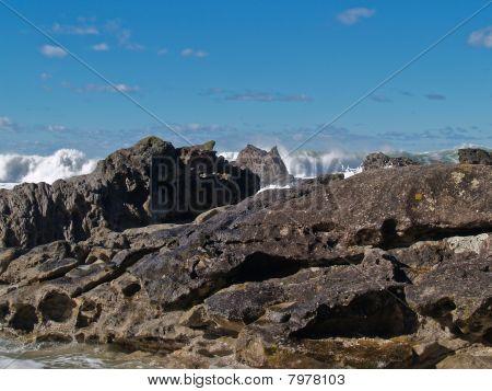 Rocky edge to ocean.