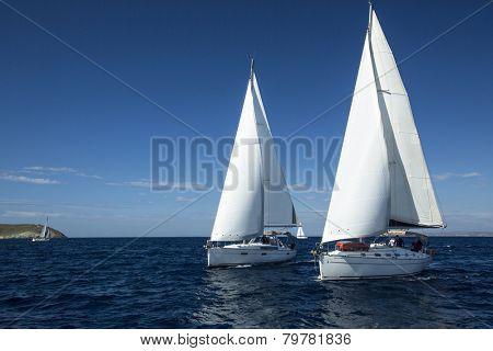 METHANA - POROS - ERMIONI, GREECE - APR 28, 2014: Unidentified sailboats participate in sailing regatta