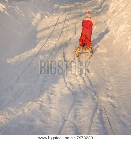 Child pulling sleigh