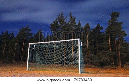 Football goal on a soccer pitch at night