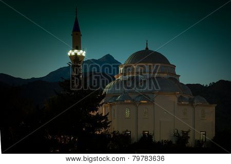 Cirali, Turkey - September 10Th 2013: Local Cirali Mosque At Night With Mount Olympus In Background