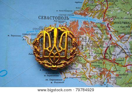 Kiev,Ukraine.JAN 10.Illustrative editorial.Ukrainian army cockade.With map of Sevastopol,Crimea. Former Ukraine.At present time Russia. At January 10,2015 in Kiev, Ukraine