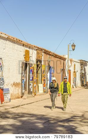 SAN PEDRO DE ATACAMA, CHILE, MAY 17, 2014: Tourists walk down a commercial street