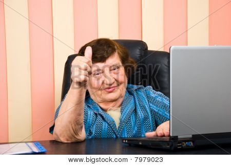 Older Corporate Woman Giving Thumbs