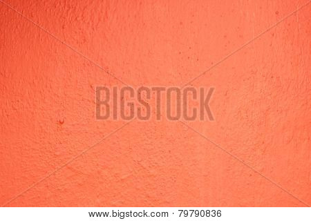 Freshly painted uneven red wall surface texture