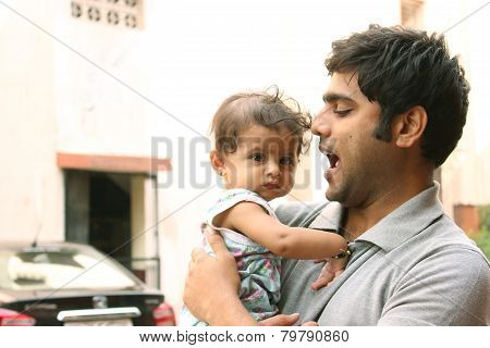 Indian Man playing with his daughter