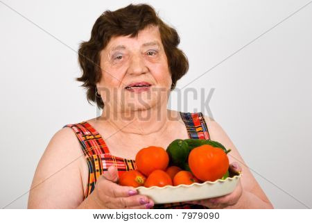 Cheerful Grandma Holding Fresh Vegetables