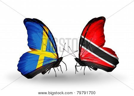 Two Butterflies With Flags On Wings As Symbol Of Relations Sweden And Trinidad And Tobago