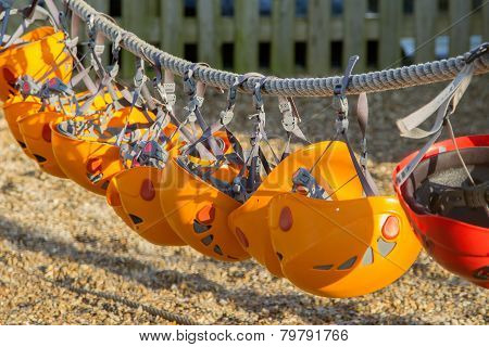 Row of orange climbing safety helmets