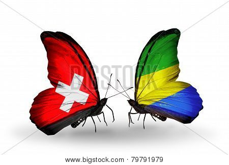 Two Butterflies With Flags On Wings As Symbol Of Relations Switzerland And Gabon