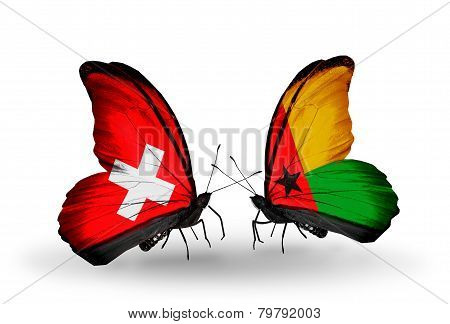 Two Butterflies With Flags On Wings As Symbol Of Relations Switzerland And Guinea Bissau