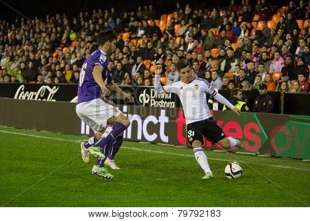 VALENCIA, SPAIN - JANUARY 4: Gaya with ball and Lucas during Spanish King Cup match between Valencia CF and R.C.D. Espanyol at Mestalla Stadium on January 4, 2015 in Valencia, Spain
