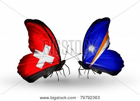 Two Butterflies With Flags On Wings As Symbol Of Relations Switzerland And Marshall Islands