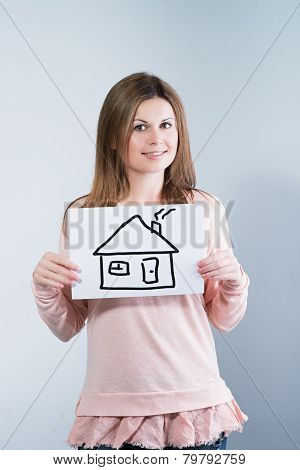 Woman Holding Picture With House