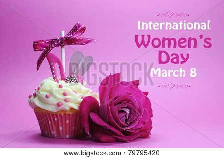 Happy International Womens Day Greeting With Pink Rose And Cupcake With High Heel Shoe On Pink Backg