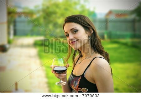 Beautiful girl with the glass of wine