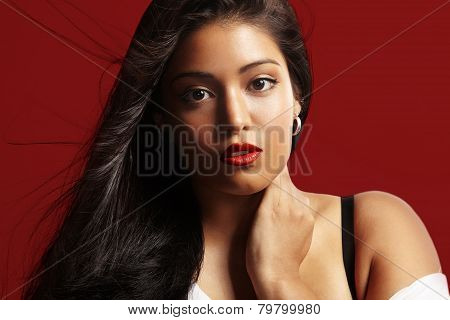 Surprised Beauty Woman On A Red Background