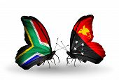 stock photo of papua new guinea  - Two butterflies with flags on wings as symbol of relations South Africa and Papua New Guinea - JPG