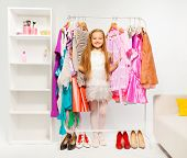 pic of shoes colorful  - Cute girl among colorful bright dresses - JPG