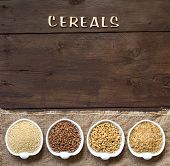 picture of cereal bowl  - Cereals in bowls border with word Cereals on wood - JPG