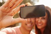 foto of two women taking cell phone  - Couple On Holiday Taking Selfie With Mobile Phone - JPG