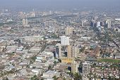stock photo of smog  - Aerial view of the Santiago city with the blue smog from the San Cristobal Hill - JPG