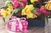 picture of daffodils  - spring tulips and daffodil flowers with pink gift box - JPG
